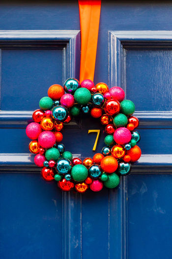 Close-up of multi colored decorations hanging on door