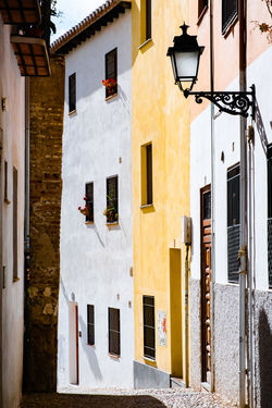Granada Granada, Spain Apartment Architecture Building Building Exterior Built Structure City Cobbled Street Cobbled Streets Day House Lighting Equipment Low Angle View Nature No People Old Outdoors Residential District Street Sunlight Town White Color Window Yellow