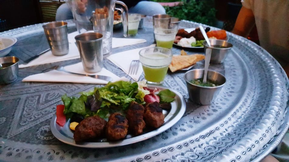 EyeEm Selects Plate Food And Drink Table Food Meat Healthy Eating Outdoors Ready-to-eat Day Freshness Kofta Egyptian Food Mojito Traditional Egyptian Restaurant Rooftop Al Fresco African African Food Salad Place Setting Table Setting Cafe Culture
