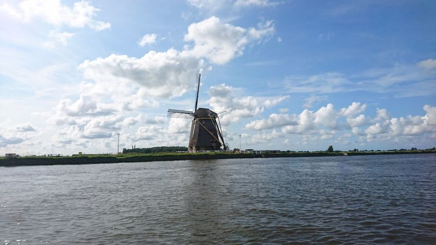Total dutchness: wide low skies, windmill and water. Cloud - Sky Wind Power History Alternative Energy Architecture Wind Turbine Windmill Sky Traditional Windmill Travel Destinations Outdoors No People Day Built Structure Building Exterior Water City Cityscape Politics And Government Netherlands River Zuid Holland Zuid-Hollands Landschap Braassemmermeer