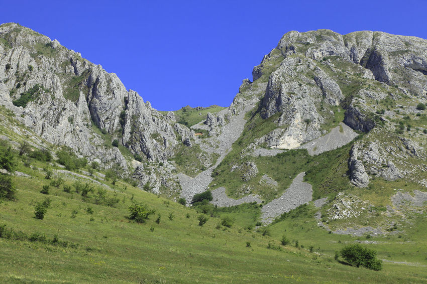 Trascau Mountains in Transylvania,Romania. Apuseni Trascau Trascau Mountains Apuseni Mountains Background Beauty In Nature Clear Sky Green Color Landscape Mountain Mountain Range Mountains Mountains And Sky Nature No People Outdoors Rock - Object Scenics Tranquil Scene Tranquility
