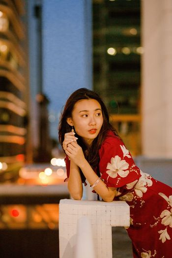 Close-up Head And Shoulders Exterior Portrait Of A Woman Portrait Photography Night Night Photography Urban Girls Sitting Portrait