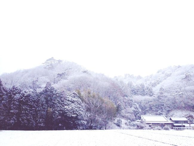 The snow-covered mountains make a beautiful winter scene.
