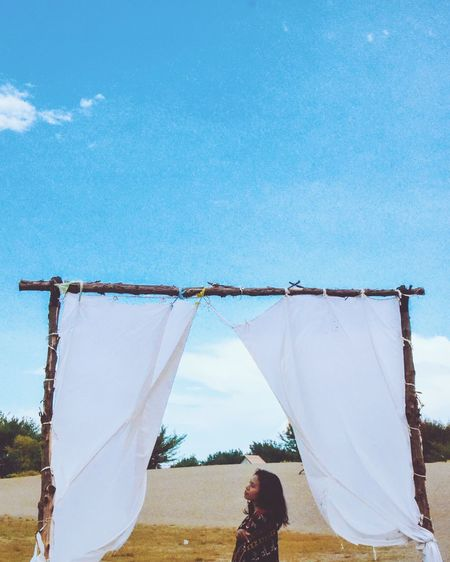 Girl Tenun Ikat Indonesia Blue Sky Sand Dune Domestic Life Clothesline