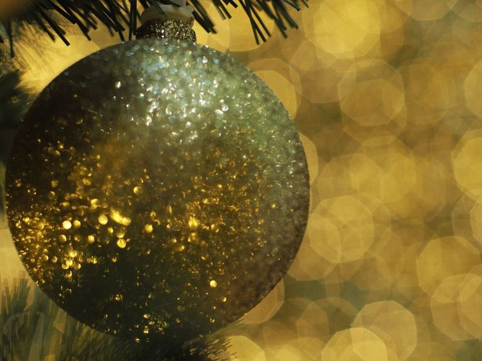 Close-up Sphere Gold Colored Celebration Christmas No People Christmas Decoration Decoration Christmas Ornament Holiday Focus On Foreground Shiny Illuminated Geometric Shape Shape Circle Pattern Lens Flare Ball