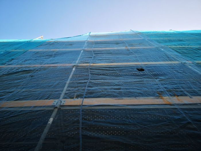Low Angle View Of Scaffolding Buildings Against Clear Sky