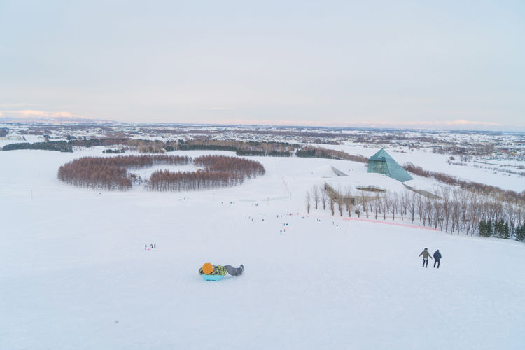 Beauty In Nature Cold Temperature Day Environment Group Of People High Angle View Land Landscape Nature Non-urban Scene Outdoors Scenics - Nature Sky Snow Sport Tranquil Scene Tranquility Water Winter