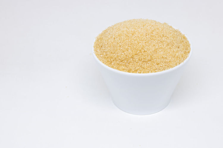 High angle view of bread in bowl against white background