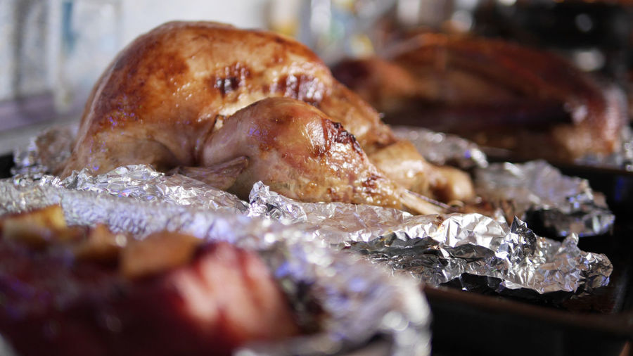 Close-up of roasted chicken meat in foil