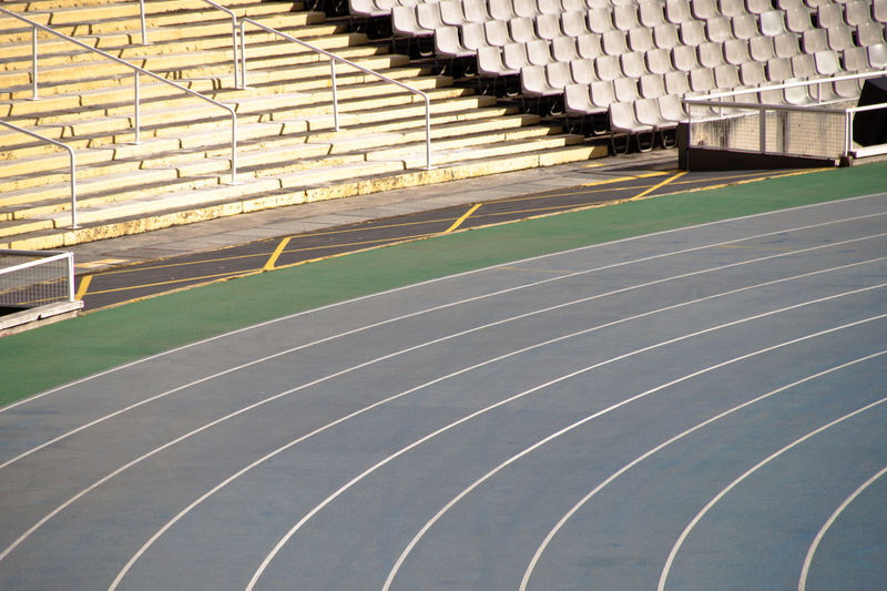 View of an empty stadium with blue running track