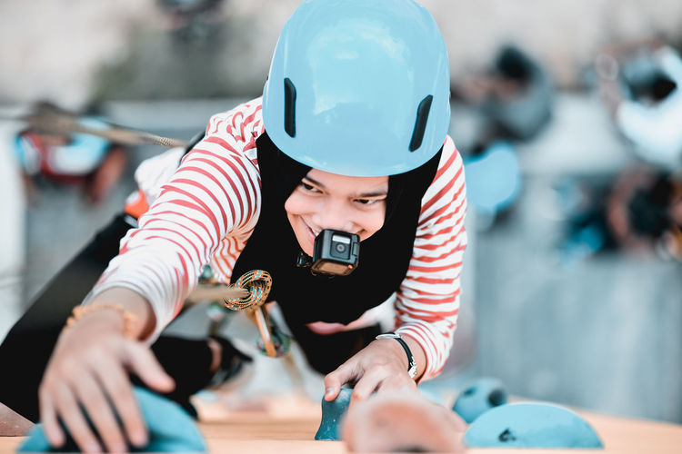 Girl Power Adventure Focus On Foreground Gopro Headwear Helmet Leisure Activity Lifestyles Outdoors Summer Camp Team Building Wall Climbing Summer Sports International Women's Day 2019