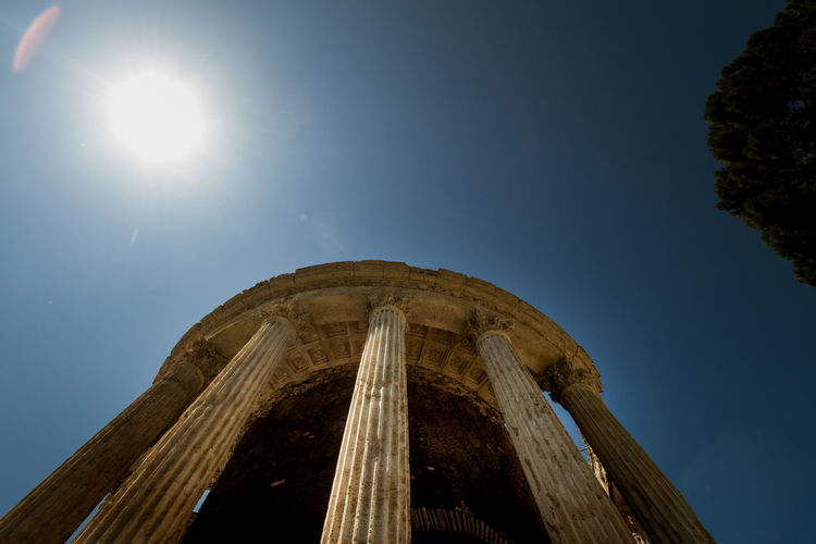 Architecture Beauty In Nature Blue Bright Built Structure Column Day Historical Building Lens Flare Low Angle View Nature No People Old Buildings Old Ruin Outdoors Roman Rome Sky Sun Sunbeam Sunlight Sunny Tranquility