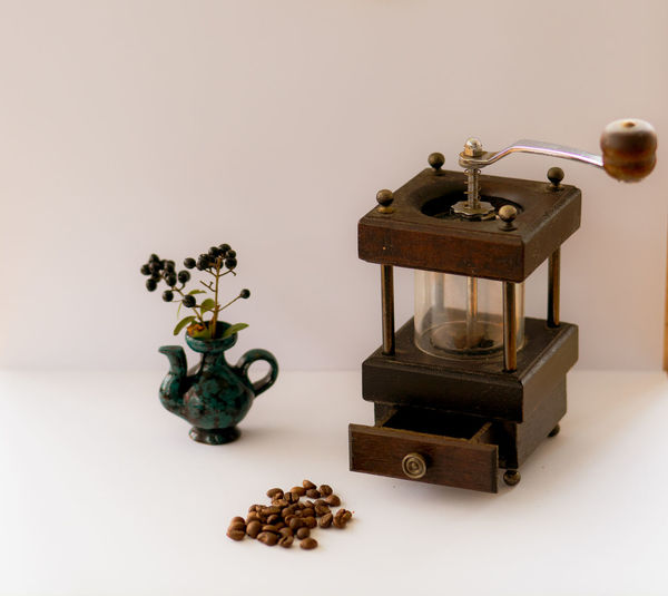 Close-up of old objects on table against white background