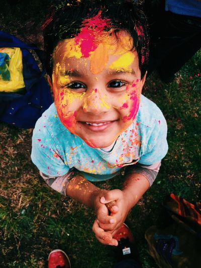 Boys Casual Clothing Childhood Cute Elementary Age Festival Field Front View Girls Grass Happiness High Angle View Holi Innocence Leisure Activity Lifestyles Looking At Camera Person Portrait Smiling