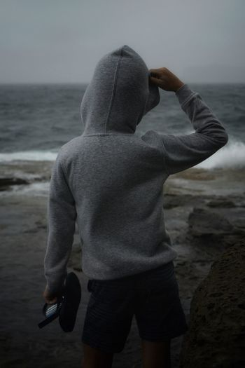 Sea Real People Water Beach Standing Rear View Lifestyles Day Hooded Shirt Leisure Activity Outdoors Nature Hood - Clothing Shore Sky Inner Power Autumn Mood