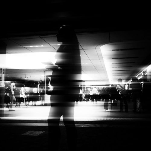 Blurred motion of woman in dark room
