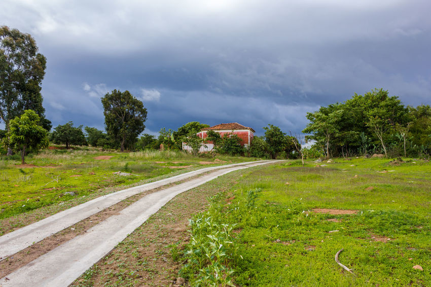 Old House under the Storm Angola Travel Vacations Africa Architecture Beauty In Nature Building Exterior Built Structure Cloud - Sky Day Destination Grass Huila  Lubango Nature No People Outdoors Road Scenics Sky Summer Tourism Tree