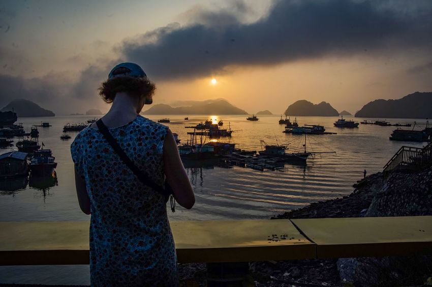 traveling Vietnam 2018 ASIA Travel Traveling Vietnam Architecture Beauty In Nature Casual Clothing Cloud - Sky Explore Leisure Activity Lifestyles Nature Nautical Vessel One Person Outdoors Real People Scenics - Nature Sea Sky Standing Sunset Three Quarter Length Transportation Water