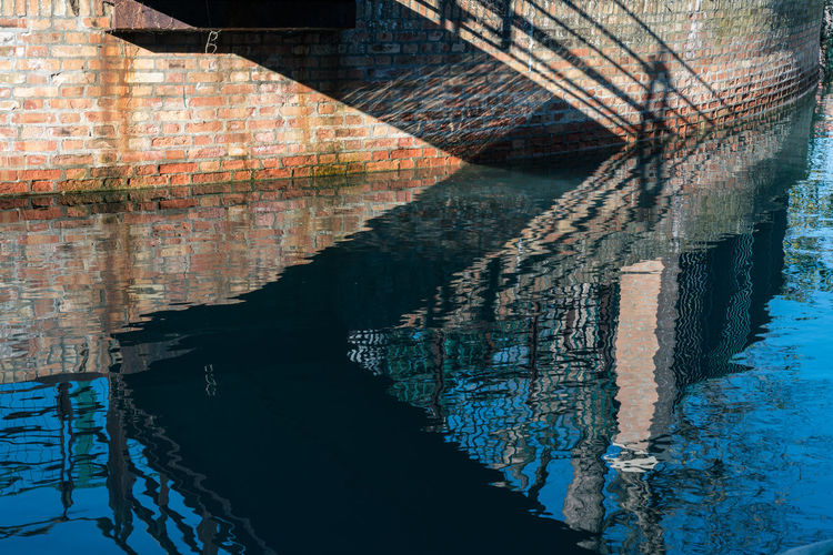 Reflection of old building in water