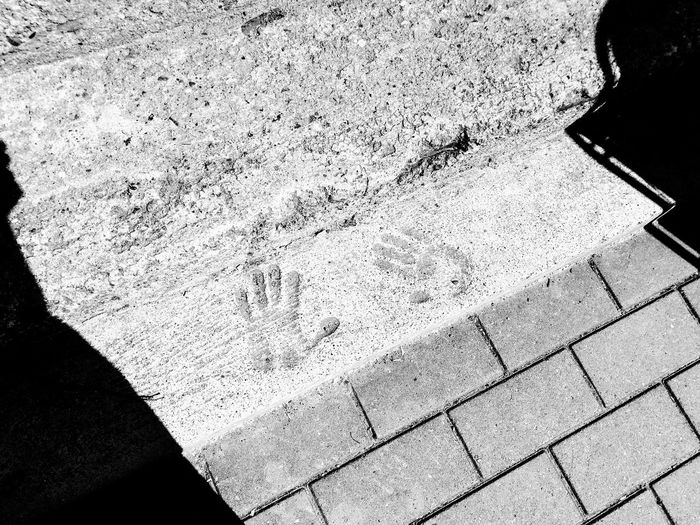 handprints Stopping Time Together Forever Togetherness Friendship Togetherness No Matter What Belongingness Love Traces Of Time Trace Leaving A Mark Timeless Handprint Blackandwhite Textured  High Angle View Full Frame Backgrounds Close-up Paved Stone Tile Paving Stone The Street Photographer - 2018 EyeEm Awards