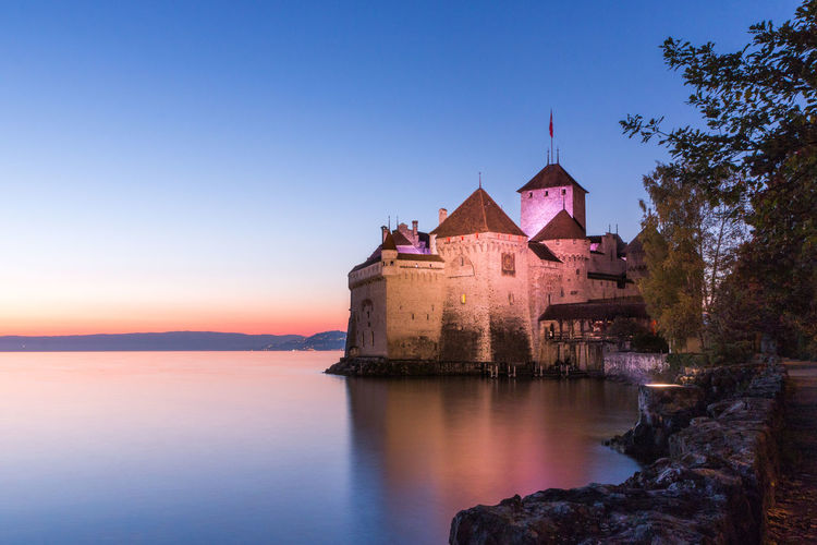 Castle Chateau De Chillon Chillon Castle Swiss Castle Architecture Beauty In Nature Building Exterior Built Structure Clear Sky Day Nature No People Outdoors Scenics Sky Sunset Tree Water