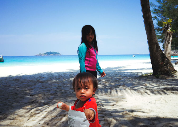 Pulau Redang, Terengganu, Malaysia. Child Childhood Beach Land Sea Real People Water Sky Leisure Activity Family Lifestyles Casual Clothing Innocence Nature Girls Two People Portrait Horizon Over Water Outdoors