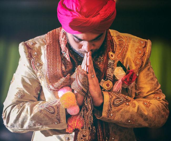 Bridegroom praying during wedding