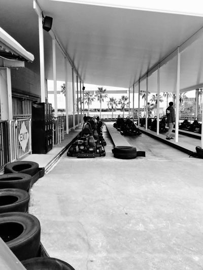 Leisure Activity Exciting Adventure Go Carts Built Structure Entrance Covered Day Blackandwhite Attendant Tires Track Go Cart Racing Indoors  In A Row Architecture Built Structure Luxury Day Modern