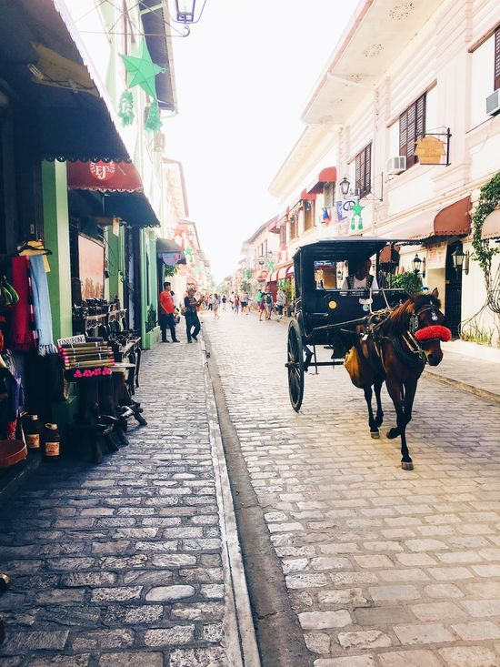 Calesa in the streets of Calle Crisologo in Vigan City, Philippines. A UNESCO World Heritage Site. Traveling Home For The Holidays