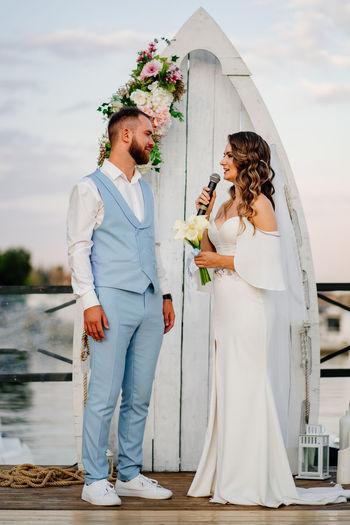 Couple holding umbrella