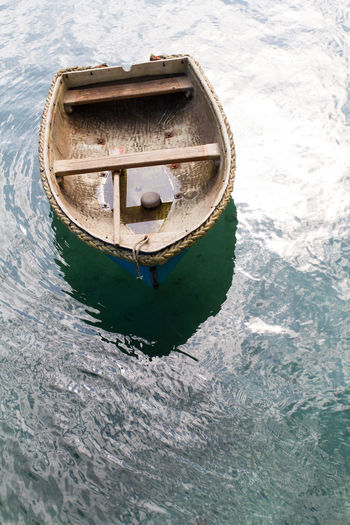 High angle view of boat moored in water