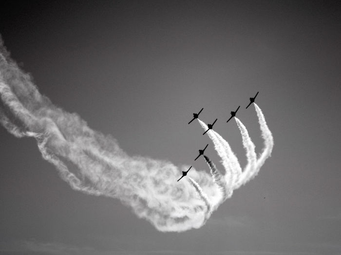 Aerobatics Air Vehicle Airplane Airshow Black Black And White Chemtrails Day Fighter Plane Flying Formation Flying Mid-air Military Airplane Motion No People Outdoors Silhouette Sky Speed Transportation