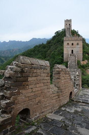 Great wall of china against sky at jinshanling