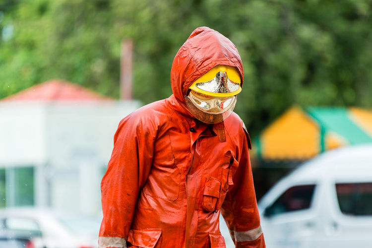 Firefighter wearing protective workwear while standing outdoors