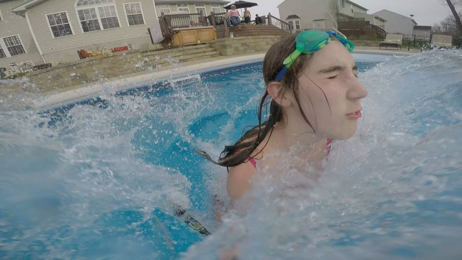 Close-up of teenage girl swimming in pool