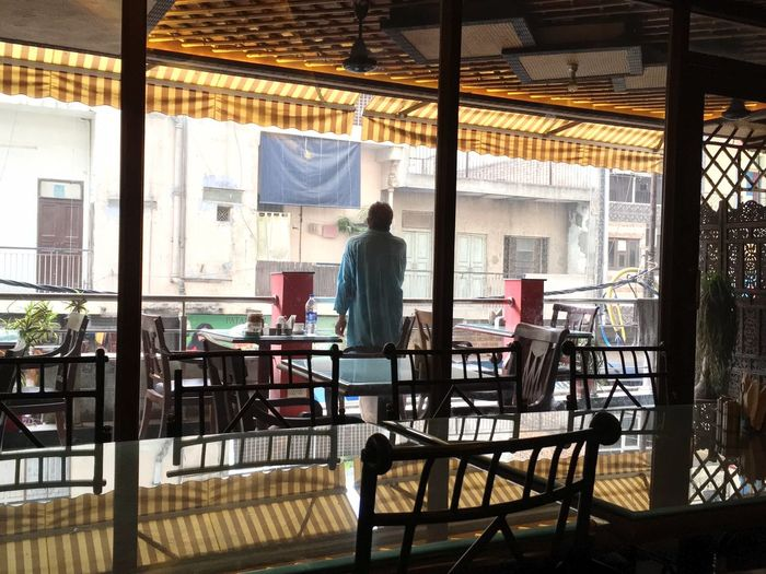 Rear view of man standing in restaurant