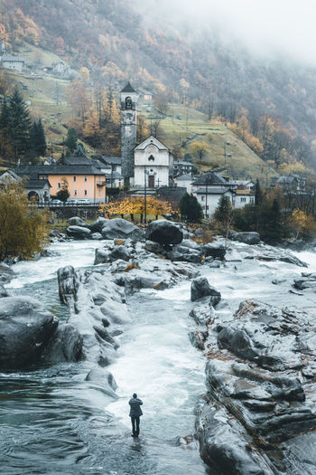 beautiful village in Switzerland Water Architecture Nature Building Motion Scenics - Nature Cold Temperature City Rock Flowing Water Winter Outdoors Flowing River Rock Church Building Exterior Old Buildings Old Town Ancient Autmun Fog Foggy