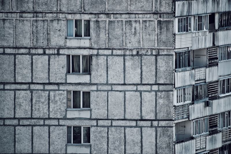 City views are not always beautiful 🏚 Urban Geometry Grey Building Depressive Atmosphere Old Buildings Building Exterior Built Structure Architecture Window Full Frame Backgrounds No People Building Pattern Day Low Angle View Residential District City Outdoors Glass - Material Apartment Repetition In A Row Design Old