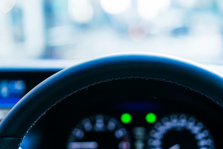 Close-up of control seen through car windshield