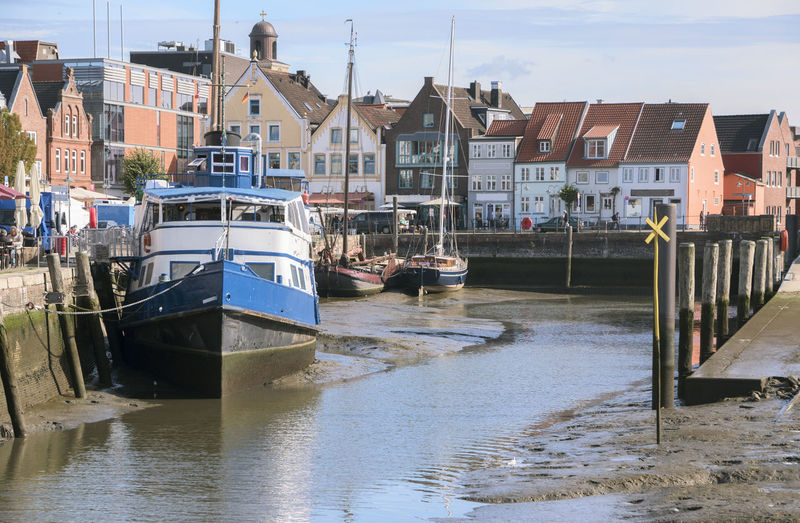 City Downtown Harbour Pier Transportation Architecture Built Structure Day Ebb Ebb And Flow Husum Infrastructure Low Tide Moored Mudflat Nature Nautical Vessel North Sea Old Port Tourism Town Transportation Wadden Sea Water