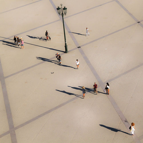 High Angle View Of People Walking On Street
