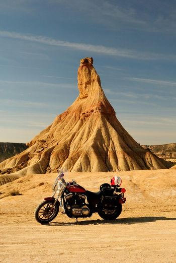 EyeEmNewHere Motorcycle Desert Landscape Arid Climate Adventure Transportation Sand Day Sky Outdoors Nature Sand Dune Bardenas Reales Navarre