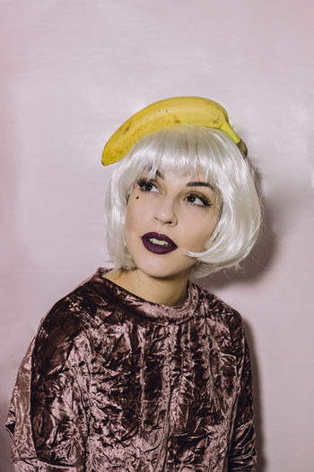 Portrait Of Young Woman With Banana On Head
