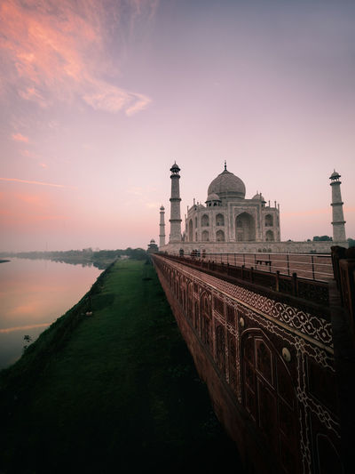 Sunrise over the beautiful Taj Mahal, India. Built Structure Building Exterior Architecture Sky Religion Sunset Water Travel Destinations Dome Place Of Worship Building History Spirituality Belief Nature Travel The Past Tourism No People Outdoors Canal Indoors  Taj Mahal Sunrise Olympus Clouds Week On Eyeem