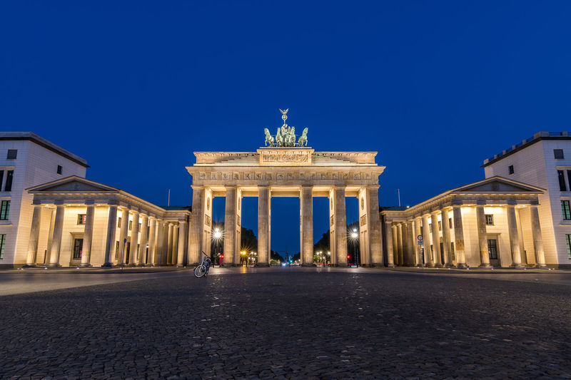 Low angle view of brandenburg gate against sky at dusk