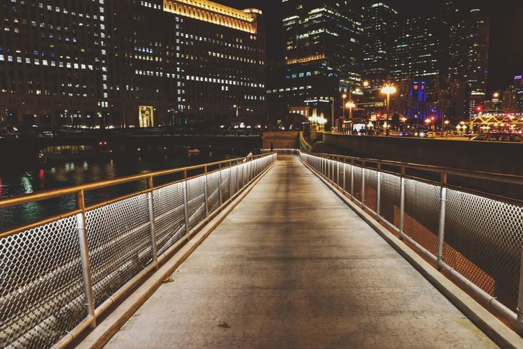 Lighted walking path in the city at night