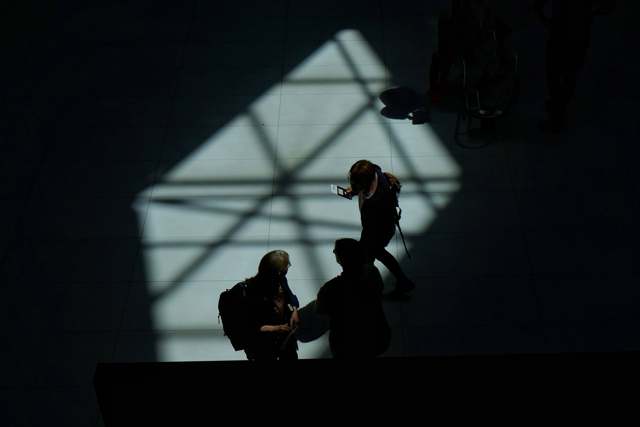 real people, standing, indoors, lifestyles, stage - performance space, women, performance, shadow, architecture, day, young adult