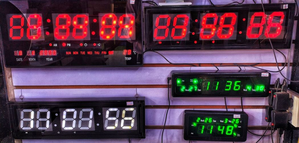 Close-up of timers on wall