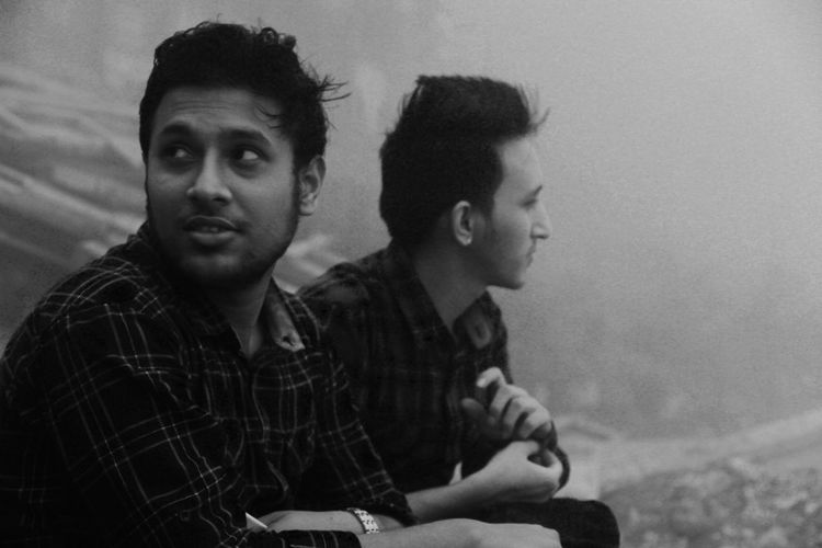 Friends Sitting Outdoors During Foggy Weather
