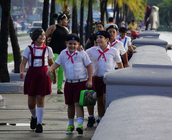 School boys and girls in Cuba Bonding Casual Clothing Che Guevara Cienfuegos, Cuba City Life Cuba Day Focus On Foreground Footpath Friendship Full Length Incidental People Laughing Leisure Activity Lifestyles Looking Love Outdoors Person School School Uniforms Around The World The Way Forward Togetherness